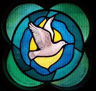 Window with white dove on blue/green background