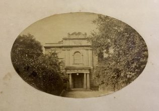 Wesleyan Chapel from New Inn Hall Street, pre 1878, black and white photo showing trees in forecourt.