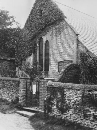 Black and white photo from 1955 showing Islip methodist church part draped in ivy.