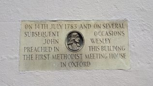 Plaque on the wall of 32-34 New Inn Hall Street recording that Wesley preached their on 14th July 1783