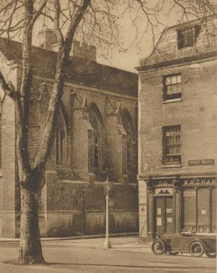 Part of a 1933 postcard showing Pusey Street leading off St Giles, with Chandler's shop on the corner on the right and the side of Pusey House on the left | Reproduced from an F Frith & Co 1933 postcard