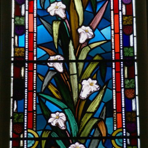 Stained glass depicting flowering white lilies