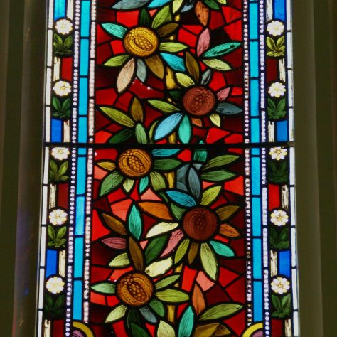Stained glass depicting fruiting pomegranate shrub
