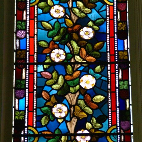 Stained glass featuring a flowering white rose