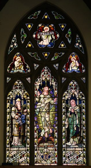 Stained glass window featuring faithful elderly servants Zechariah and Elizabeth with Christ in Glory. | WMC